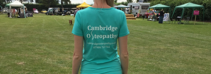 "Image of a female wearing a ""Cambridge Osteopathy"" T-shirt showing the website and telephone number"